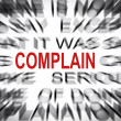 Stock Photo: Blured text with focus on COMPLAIN