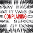 Stock Photo: Blured text with focus on COMPLAINING