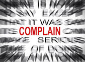 Blured text with focus on COMPLAIN — Stock Photo