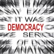 Stock Photo: Blured text with focus on DEMOCRACY