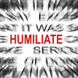 Blured text with focus on HUMILIATE — Stock Photo
