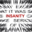 Blured text with focus on INSANITY — Stock Photo