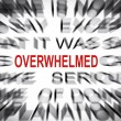 Blured text with focus on OVERWHELMED — Stockfoto