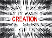Blured text with focus on CREATION — Photo