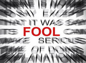 Blured text with focus on FOOL — Stock Photo