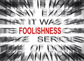 Blured text with focus on FOOLISHNESS — Stock Photo