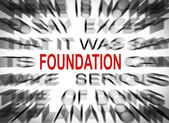 Blured text with focus on FOUNDATION — Stock Photo