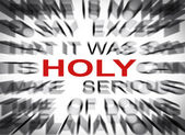 Blured text with focus on HOLY — Photo