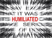Blured text with focus on HUMILIATED — Stock Photo