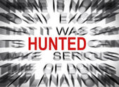 Blured text with focus on HUNTED — Foto Stock