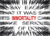 Blured text with focus on IMMORTALITY — Photo