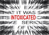 Blured text with focus on INTOXICATED — Stock Photo