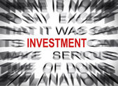 Blured text with focus on INVESTMENT — Stock Photo