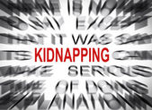 Blured text with focus on KIDNAPPING — Stock Photo
