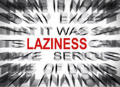 Blured text with focus on LAZINESS — Stock Photo