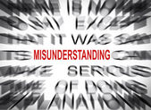 Blured text with focus on MISUNDERSTANDING — Stock Photo