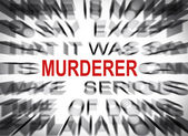 Blured text with focus on MURDERER — Stock Photo