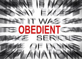 Blured text with focus on OBEDIENT — 图库照片