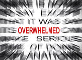 Blured text with focus on OVERWHELMED — Stock Photo