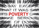 Blured text with focus on POVERTY — Stockfoto