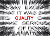 Blured text with focus on QUALITY — Stock Photo