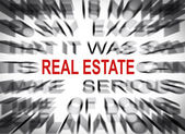 Blured text with focus on REAL ESTATE — Stock Photo