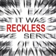 Blured text with focus on RECKLESS — Stock Photo
