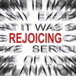 Blured text with focus on REJOICING — Stock Photo