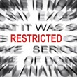 Stock Photo: Blured text with focus on RESTRICTED