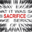 Blured text with focus on SACRIFICE — Stock Photo
