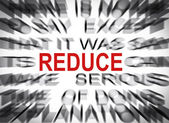 Blured text with focus on REDUCE — Stock Photo