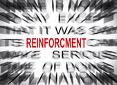 Blured text with focus on REINFORCMENT — Foto Stock