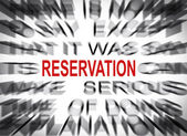 Blured text with focus on RESERVATION — Stock Photo