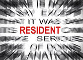 Blured text with focus on RESIDENT — Stock Photo