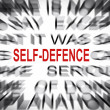 Stock Photo: Blured text with focus on SELF DEFENCE