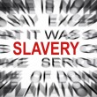 Blured text with focus on SLAVERY — Stock Photo