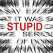 Blured text with focus on STUPID — Stock Photo