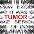 Blured text with focus on TUMOR — Stock Photo