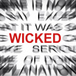 Blured text with focus on WICKED — Stock Photo