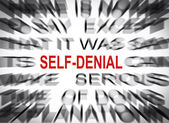 Blured text with focus on SELF DENIAL — Stock Photo