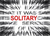 Blured text with focus on SOLITARY — Stock Photo