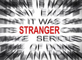 Blured text with focus on STRANGER — Stock Photo