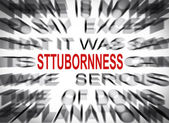 Blured text with focus on STUBBORNNESS — Stock Photo