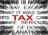 Blured text with focus on TAX — Stock Photo
