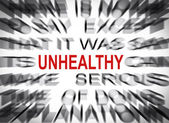 Blured text with focus on UNHEALTHY — Stock Photo