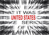 Blured text with focus on UNITED STATES — ストック写真