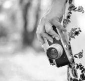 Woman hand holding retro camera close-up — Stock Photo