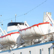 Lifeboats installed on large white passenger liner deck — Stock Photo
