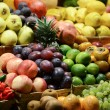 Fruit market with various colorful fresh fruits and vegetables - — Stock Photo #34335391