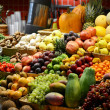Fruit market with various colorful fresh fruits and vegetables - — Stock Photo #34335635